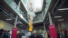 Watch more than 1,500 ping-pong balls being launched into the air.