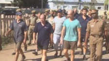The men on their release from prison in June 2014