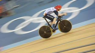 Great Britain's Ed Clancy rides in the 4000m individual pursuit at the Velodrome in the Olympic Park.