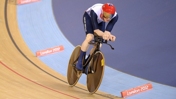 Ed Clancy rides in the 4000m individual pursuit at the Velodrome in the Olympic Park.