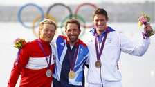 Gold medallist Ben Ainslie (centre) with silver medallist Jonas Hogh-Christensen (left) and bronze medalist Jonathan Lobert.