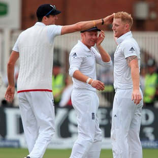 England bowler Ben Stokes celebrates taking wicket of Australia batsman Mitchell Starc with England's Steven Finn and Jonny Bairstow (centre)