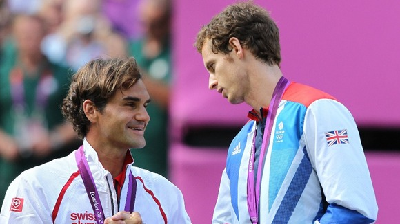 Murray embraces with Federer on the medal podium.