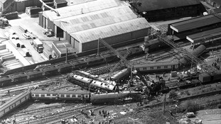Aerial shot of the mangled carriages after the sleeper train from London to Glasgow came off the tracks at Trent Valley Station