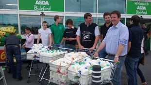 Trolleys of milk being handed out