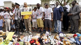 A four-and-a-half minute silence was held at the spot where Michael Brown was killed.