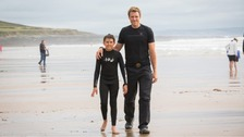 James Cracknell and his son Croyde, 11, who helped save Emerson Fairclough, 7, and his grandfather Jim Greatorex from the sea at Croyde beach