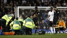 Fabrice Muamba receives medical attention during the match at White Hart Lane