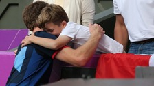 Henry hugs Team GB's Andy Murray after he won gold against Roger Federer at Wimbledon