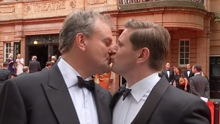 Downton Abbey stars Hugh Bonneville and Allen Leech kiss on the red carpet
