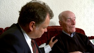 Paul Davies comforts 98-year-old Jim Crossan as he recounts his emotional story