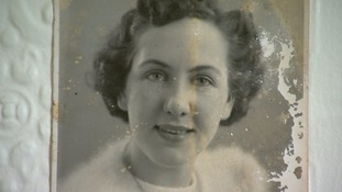 His photograph of Jean is stained from the monsoon rain