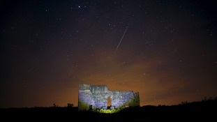 Meteors streak across the sky over a Roman theatre in the ruins of Acinipio, near Ronda, southern Spain