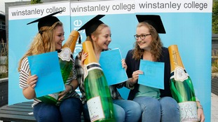 Jessica Berry, Robyn Chilton and Isabelle Cliff celebrate their A-level results at Winstanley College in Wigan, Lancashire.
