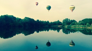 Balloons above lake