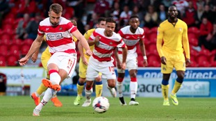 Doncaster Rovers' Andy Williams scores his side's first goal of the game from the penalty spot