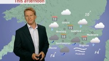 Simon Parkin in front of weather chart