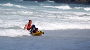Chapel Porth lifeguard Tom Evans rescuing the boy