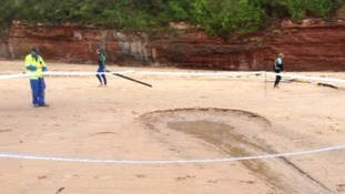 Large sinkhole on Exmouth beach could be due to blocked pipe