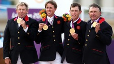 Great Britain's (from left to right) Peter Charles, Ben Maher, Scott Brash and Nick Skelton celebrate with their Gold medals