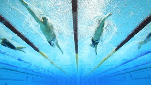 Australia's James Magnussen (left) and USA's Nathan Adrian go head to head in the Men's 100m Individual Freestyle Final
