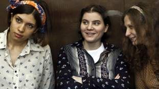 Nadezhda Tolokonnikova, Yekaterina Samutsevich and Maria Alyokhina, attend their trial in a court in Moscow in August