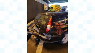 Emergency crews said the car spun into a crash barrier after colliding with a lorry