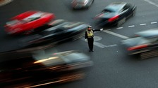 A policeman directs traffic