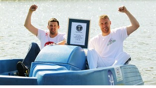Freddie Flintoff (right) and Steve Harmison celebrate after setting the fastest 100m time on a pedalo