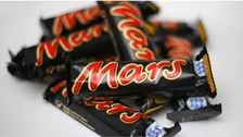 A woman was fined £328 for stealing a multi-pack of Mars bars
