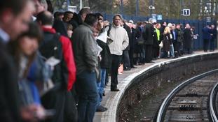 rail commuters on platform