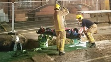 The man was rescued from the trench.