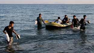 Migrants from Burma arrive on a dinghy on the Greek island of Kos.