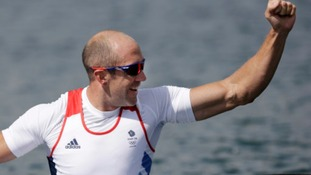 Dr Tim Brabants celebrates making the 1000 metres kayak final