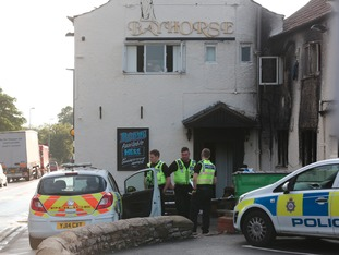 Police at the scene of the arson attack in Knottingley