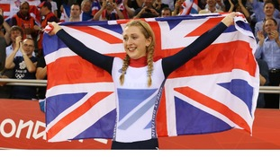 Britain's Laura Trott celebrates after the track cycling women's omnium 500m time trial at the Velodrome