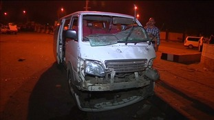 A minibus with its windscreen shattered by the blast.