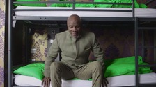 Chris Eubank tries out the bunk beds at the youth hostel.