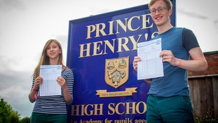 GCSE pupils with their results