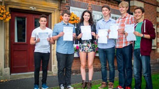 Students with their GCSE results