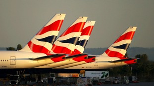 British Airways planes sit on the tarmac