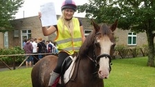 Ebony Kenington was all smiles as she collected her results on horseback!