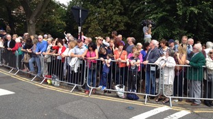 Mourners and fans line the streets of Woolton