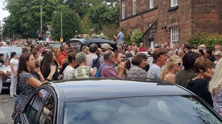 Crowds gather around Cilla's hearse