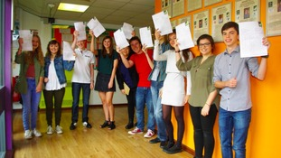 Students with their results papers