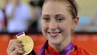 Laura Trott celebrates with her Gold medal after winning the Women's Omnium