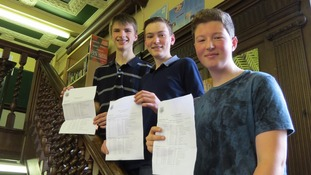 Students hold up their results