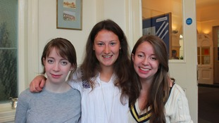 Three students collect their results together