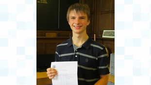 Student poses with his results
