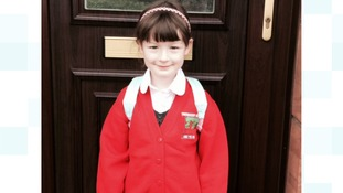 Kyla Shortt on her first day as a P1 at Troqueer Primary. Big smiles for mummy Julie and daddy Phil.